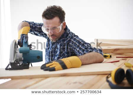 man crouching with circular saw stock photo © photography33