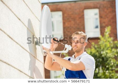 Young antenna installer Stock photo © photography33