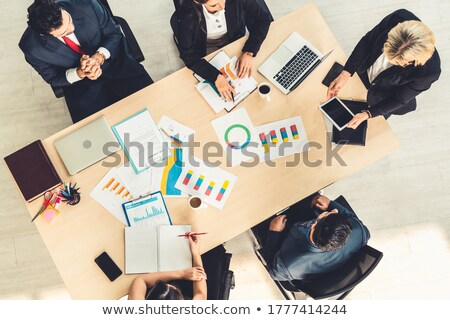 High angle shot of business woman sitting at the desk Stock photo © dash