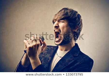 Man shouting into a microphone Stock photo © photography33