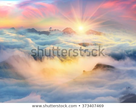 beautiful rainbow over the mountain with dark clouds  Stock photo © meinzahn