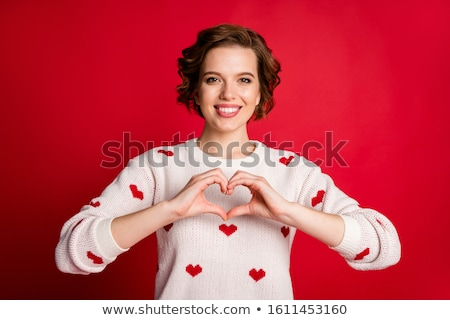 Young brown-haired woman with red heart in hands Stock photo © photography33