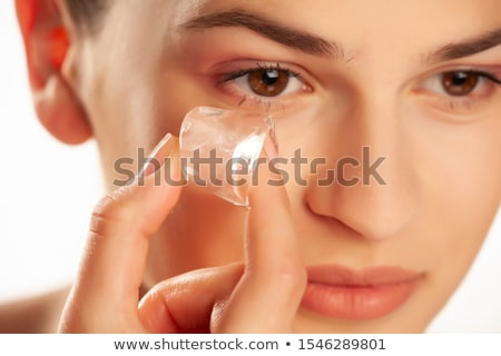woman holding ice cube on her face Stock photo © chesterf