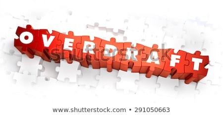 overdraft   white word on red puzzles stock photo © tashatuvango