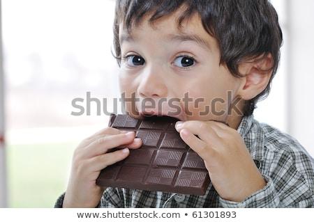 Little boy eating chocolate cake Stock photo © d13