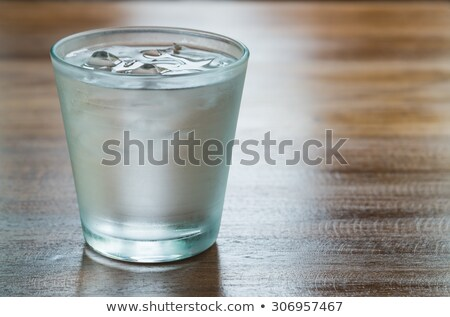 Glass of iced water on wooden table Stock photo © punsayaporn