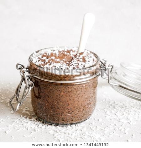 Csokoládé puding mag üveg tálak magok Stock fotó © ildi
