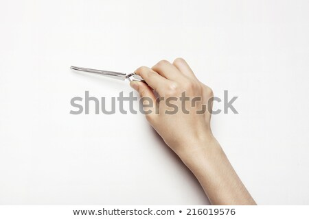 woman hand holding red pliers stock photo © punsayaporn