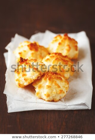 tiny light coconut cookies on old table stock photo © dariazu