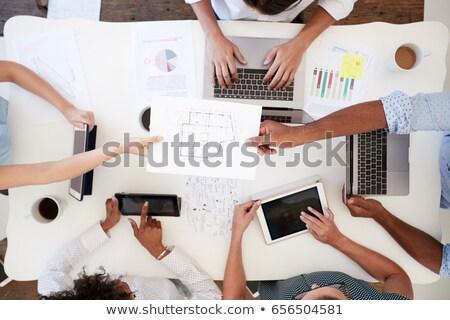 Overhead shot of woman, coffee, laptop, and tablet Stock photo © wavebreak_media