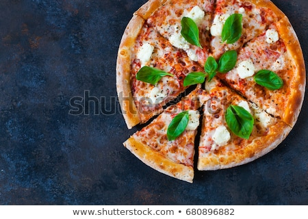 Margherita Pizza on dark rusty background Stock photo © Yatsenko