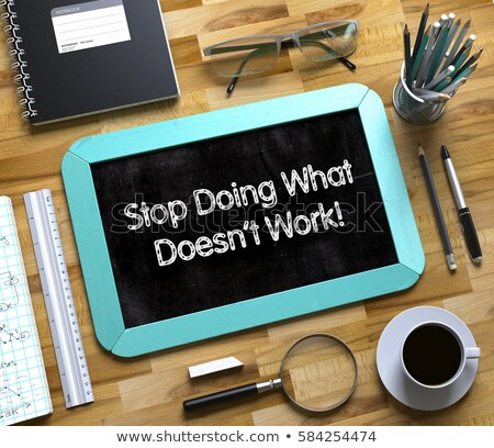Small Chalkboard with Stop Doing What Doesnt Work Concept. 3D. Stock photo © tashatuvango