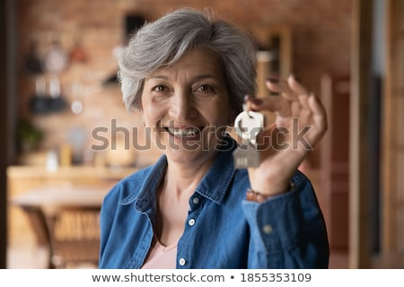 woman holding a key stock photo © grafvision