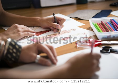 young women working as fashion designer drawing sketches for clo Stock photo © snowing