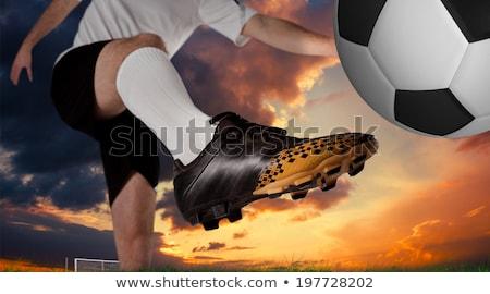 Football player in white kicking against digitally generated iranian national flag Stock photo © wavebreak_media