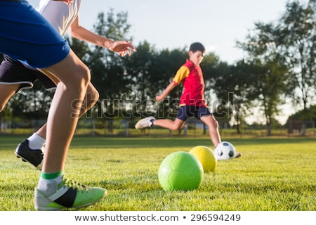 Stock photo: school boy Green jersey Sports & exercise