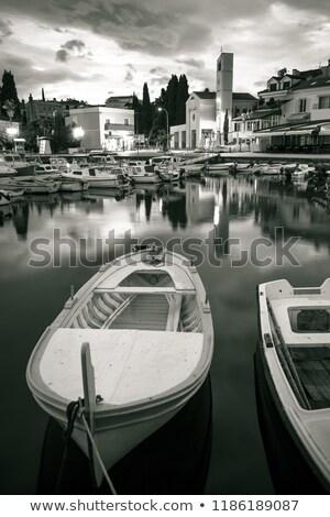 village · bord · de · l'eau · aube · plage · ciel · bâtiment - photo stock © xbrchx