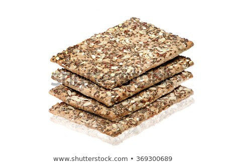 Crispy organic bread slices with flax seeds and sesame macro pho Stock photo © artjazz