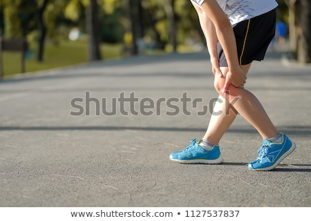 Young woman have knee pain during training Stock photo © boggy