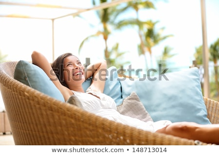 happy asian young dreaming woman at home Stock photo © dolgachov