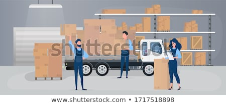 male worker with loader working at warehouse stock photo © dolgachov