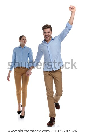 winning man walks and hold hands with casual woman Stock photo © feedough