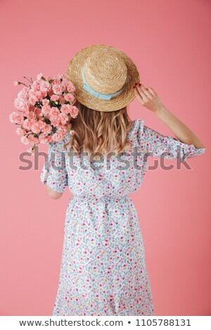 Stock photo: Pretty young beautiful woman posing isolated over pink background showing hopeful gesture.