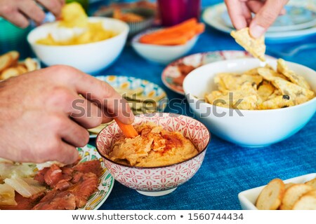 people having some appetizers on a colorful table Stock photo © nito