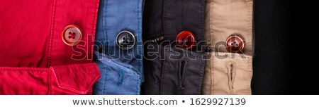 Banner of fagment of four cotton twill pants red, blue, black, beige with open buttons. Stock photo © Illia