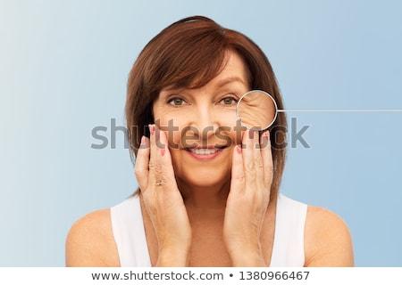 senior woman with zoomed eye wrinkles Stock photo © dolgachov