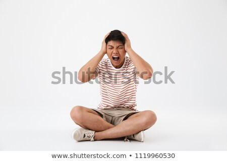 An angry man sitting cross-legged Stock photo © photography33