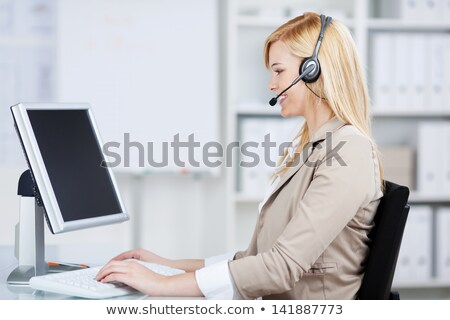smiling woman using headphones and mike stock photo © stryjek