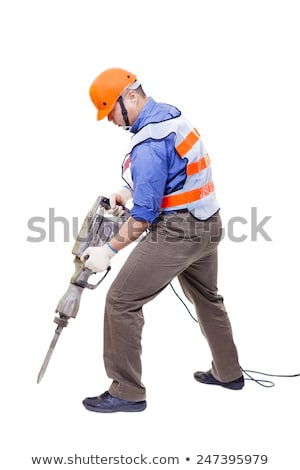 laborer holding a drill isolated on white background stock photo © photography33