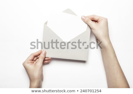 Female hand holding up the letter A from top Stock photo © stryjek