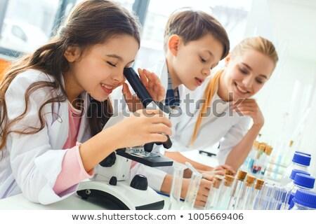 çocuklar · öğretmen · kadın · okul · laboratuvar · kızlar - stok fotoğraf © lunamarina