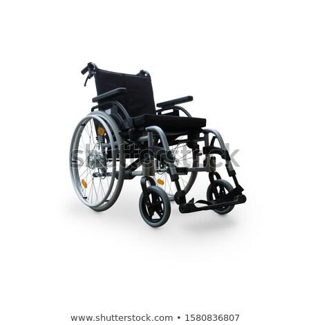 Empty Wheelchair on White Background Stock photo © iqoncept
