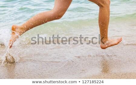 feet of boy running along the beach Stock photo © meinzahn