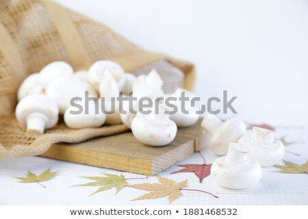 Mushrooms on cutboard. Stock photo © iofoto