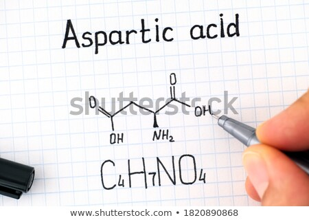 Hand with pen drawing the chemical formula of aspartic acid Stock photo © Zerbor