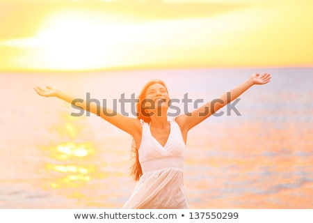 Smiling Pretty Girls at the Beach During Sunset Stock photo © belahoche