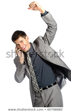 Handsome businessman talking on his mobile phone over white background Stock photo © deandrobot