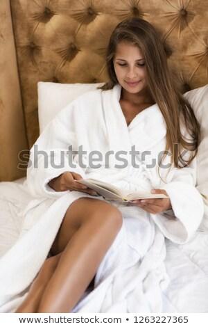 függőleges · kép · csinos · nő · fürdőköpeny · tart · könyv - stock fotó © deandrobot