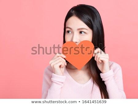 girl holding paper heart stock photo © lightfieldstudios