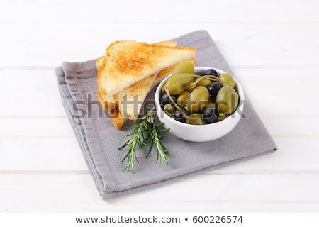 pickled olives, capers and caper berries with toast Stock photo © Digifoodstock