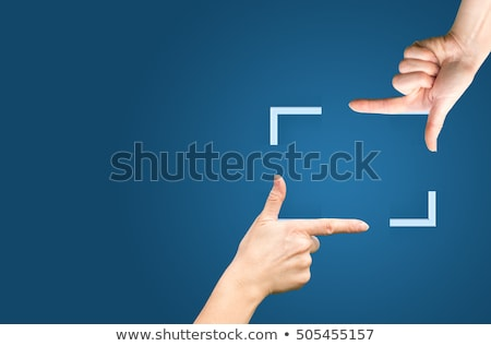 Woman with hands in the way of the shot Stock photo © IS2