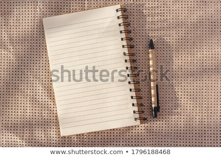 Notepad (copybook) with spiral and pencil on light wooden table, Stock photo © Nobilior