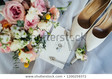 Bridal bouquet, invite list and bride shoes Stock photo © ruslanshramko
