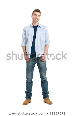 Portrait of a happy young casual man standing stock photo © deandrobot