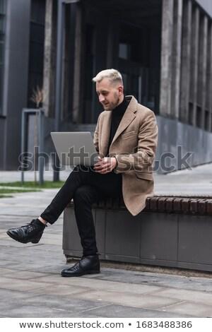 Yakışıklı işadamı oturma açık iş yüz Stok fotoğraf © Minervastock