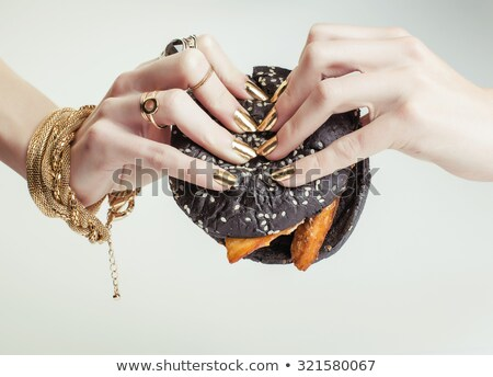woman eating delicious burger stock photo © andreypopov